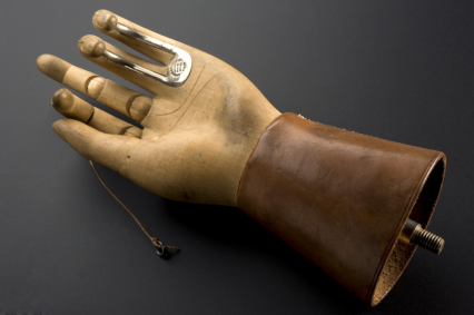 This prosthetic hand was designed by Thomas Openshaw around 1916 while working as a surgeon for Queen Mary's Hospital. Two fingers of the wooden hand are reinforced with metal hooks to help with daily tasks.